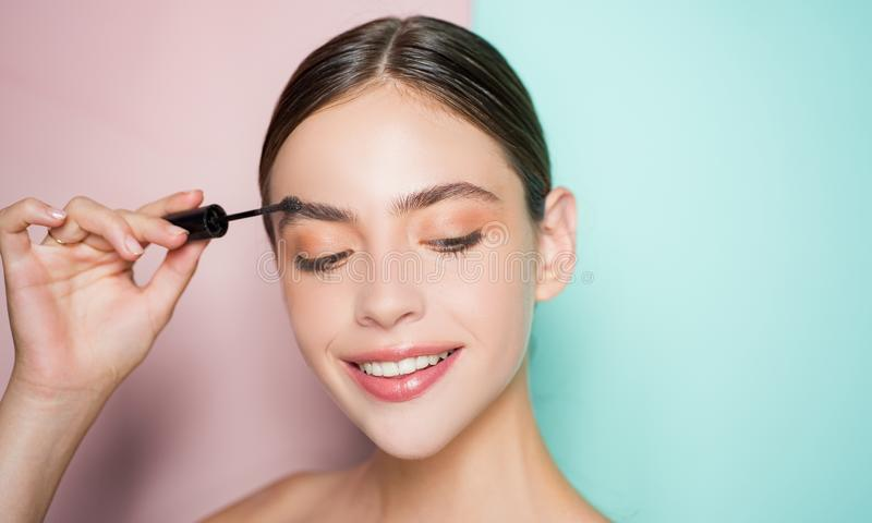Beautiful thick eyebrows, a vivid glance. Perfect eyebrows, make-up correction. stock photography