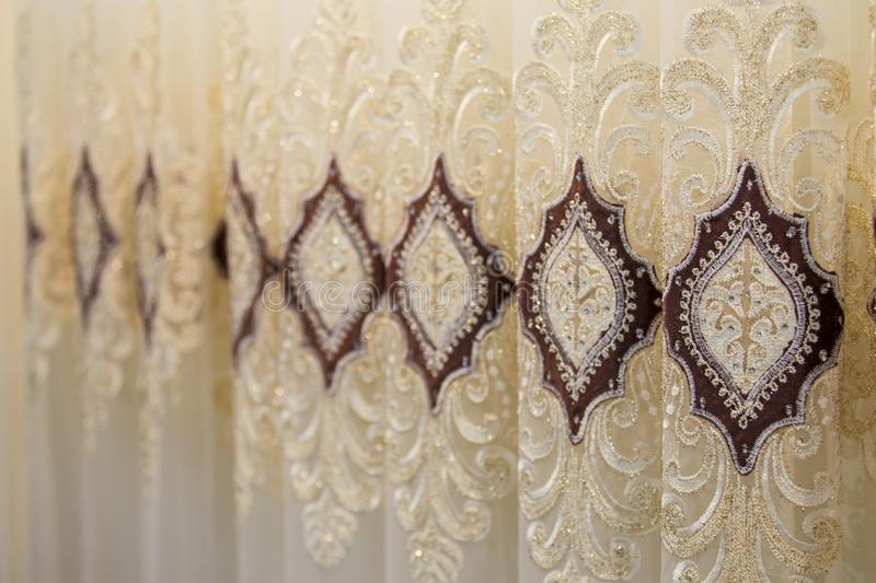 Beautiful thin curtains texture, transparent tulle, examples in the store stock photography