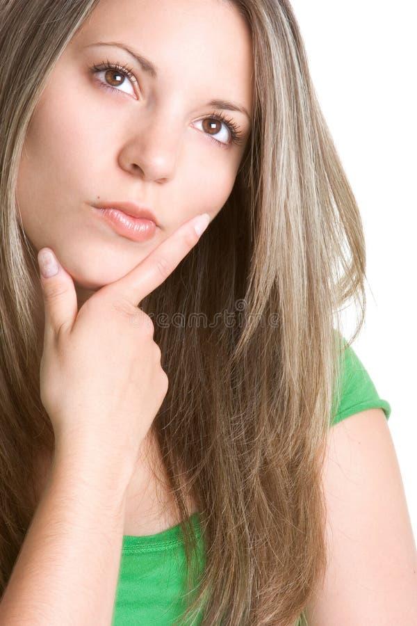 Beautiful Thinking Woman. Beautiful isolated young woman thinking royalty free stock image