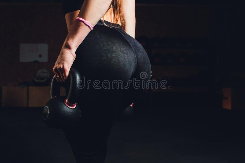 Beautiful in thong. Fitness girl, athletic woman working out with dumbbells stock photo