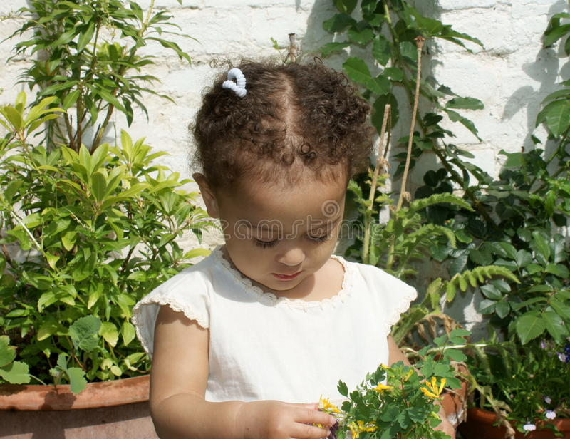 Download Beautiful Thoughtful,child With Flowers Stock Photo - Image: 20335824