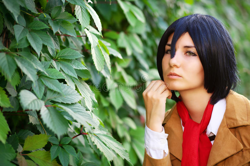 Beautiful thoughtful girl anime character near the leaves. In the park stock photos