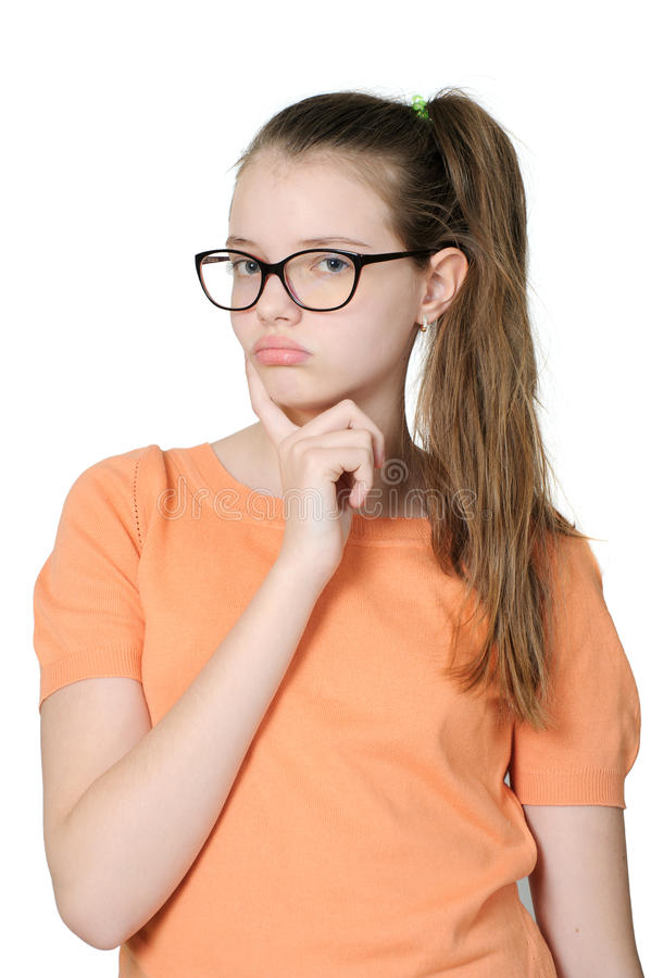 Beautiful thoughtful girl on a clean white background. royalty free stock image