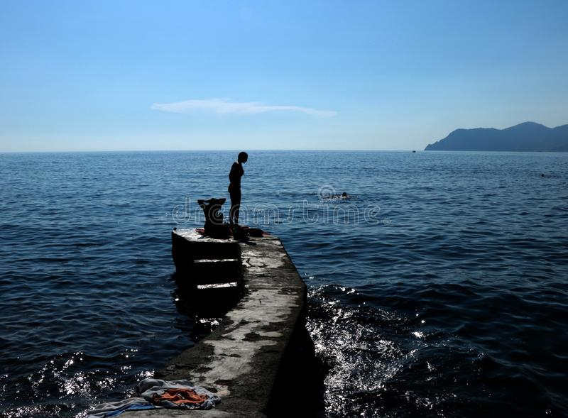 Magic Hour on the Water_2. Beautiful time of day to capture silhouettes on the oceanside. Liguria CinqueTerre is paradise on earth for those who love boating stock photo