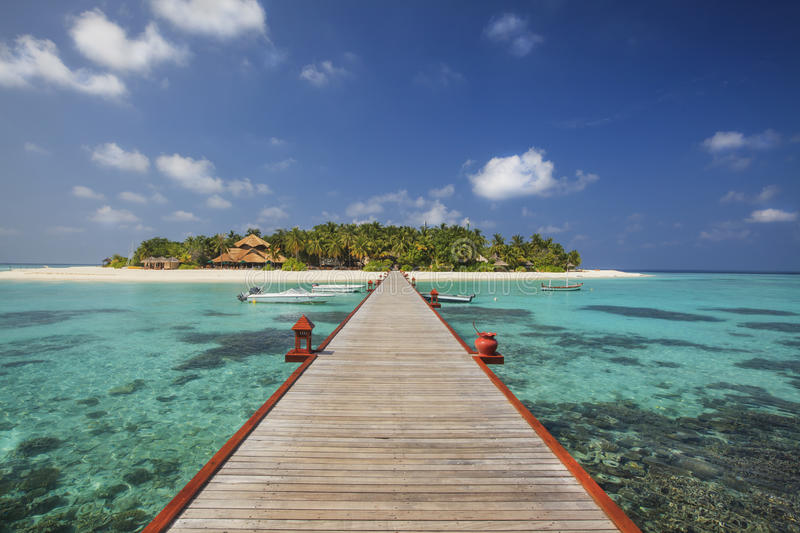 Beautiful tiny island in Maldives in sunny day. royalty free stock image