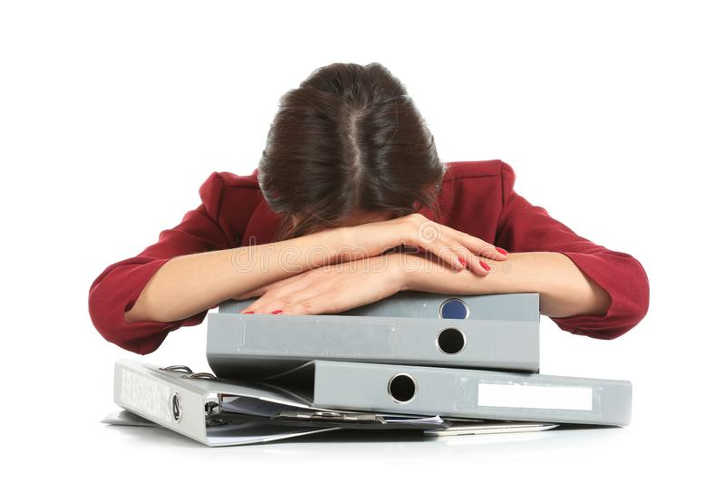 Beautiful tired businesswoman with folders on white background stock photos