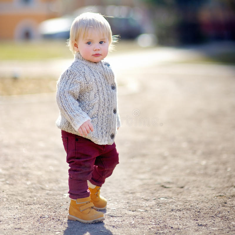 Beautiful toddler boy walking. Outdoors at the warm spring day royalty free stock photo