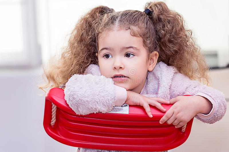 Beautiful toddler girl curly blond cool hair royalty free stock images