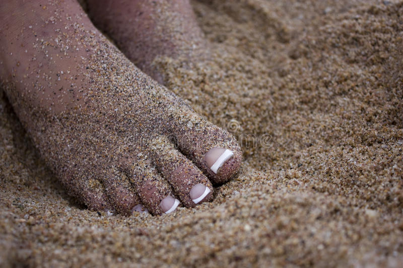Beautiful Toes In The Sand Royalty Free Stock Photography