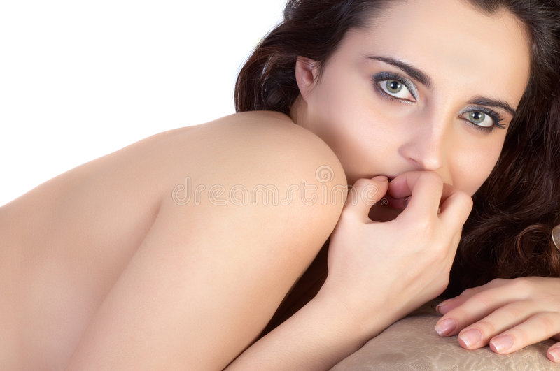 Beautiful topless girl. Lying on the sofa stock image