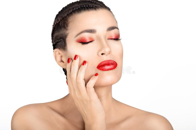 Beautiful sensual woman with red lips and nails. Beauty Makeup and Nail Art concept royalty free stock images
