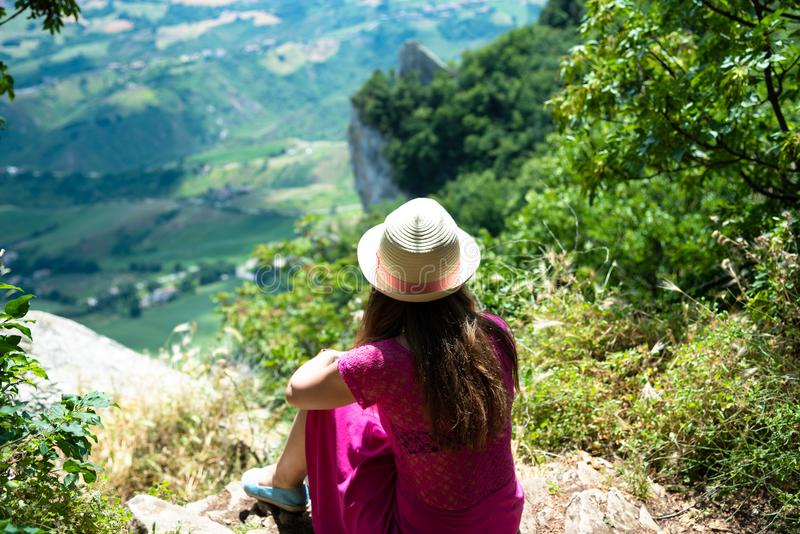 A beautiful touristic girl in the San Marino, admiring the view royalty free stock photos
