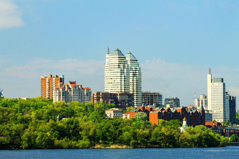 Beautiful towers, buildings and skyscrapers in the River in the early summer morning. Dnepropetrovsk, city Dnipro royalty free stock photography