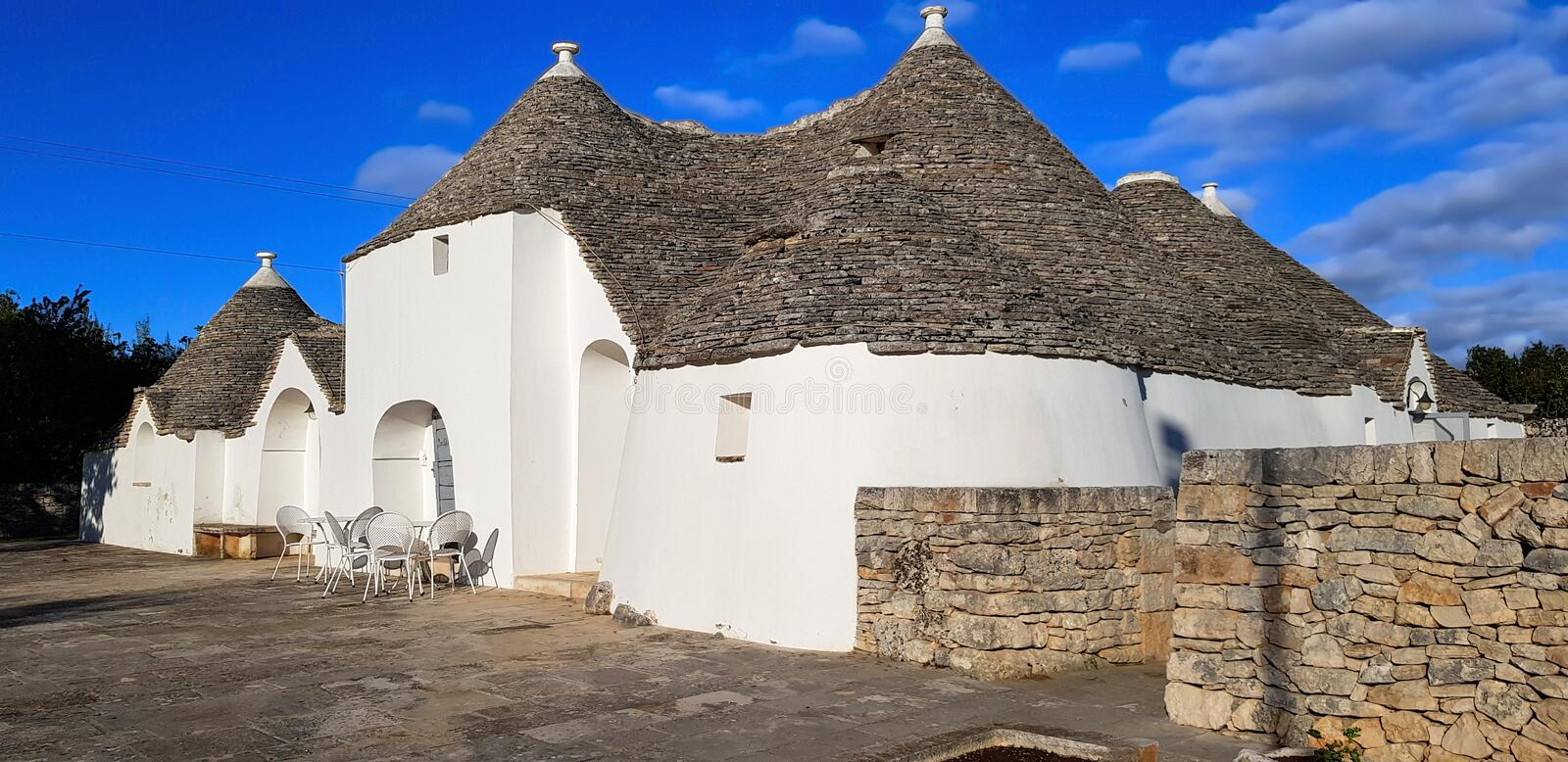 Beautiful town of Alberobello with trulli houses. It is an Italian town in the metropolitan city of Bari, in Puglia,  Italy. Beautiful town of Alberobello with stock images