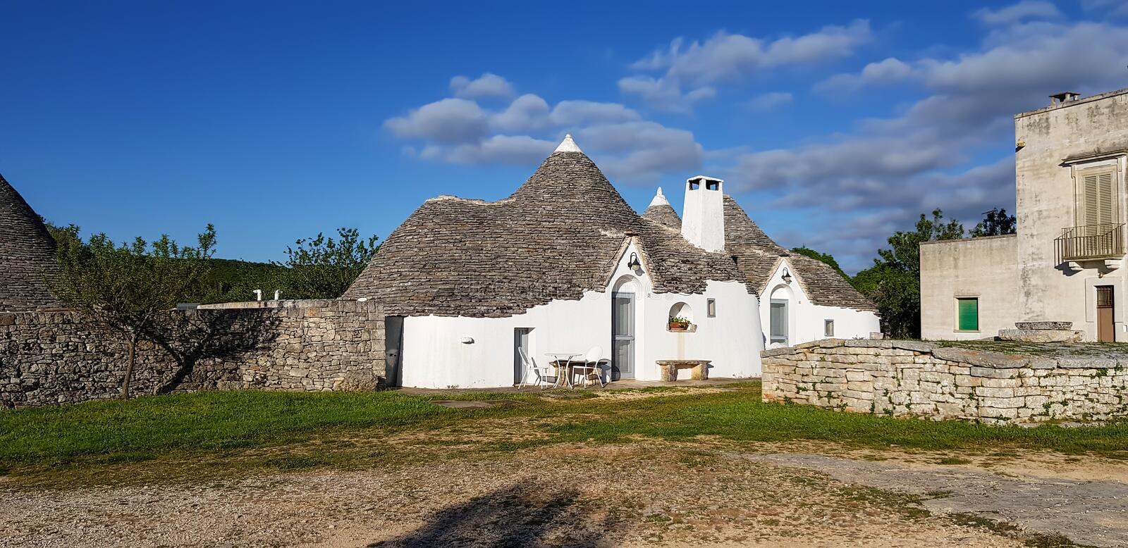 Beautiful town of Alberobello with trulli houses. It is an Italian town in the metropolitan city of Bari, in Puglia,  Italy. Beautiful town of Alberobello with stock photo