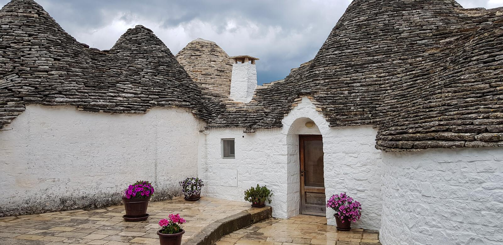 Beautiful town of Alberobello with trulli houses. It is an Italian town in the metropolitan city of Bari, in Puglia,  Italy.  stock images