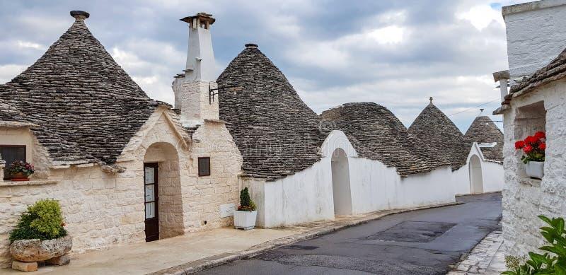 Beautiful town of Alberobello with trulli houses. It is an Italian town in the metropolitan city of Bari, in Puglia,  Italy.  stock photo