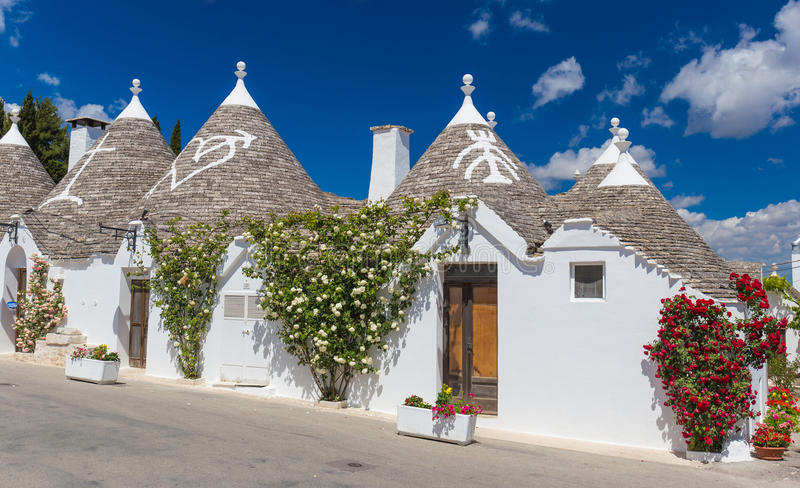 Beautiful town of Alberobello with trulli houses, main turistic district, Apulia region, Southern Italy. Beautiful town of Alberobello with trulli houses, main stock image