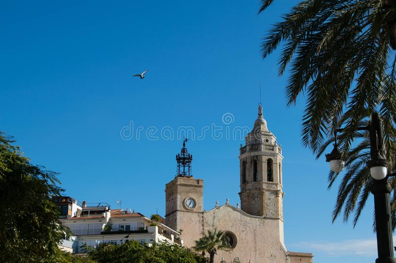The beautiful town of Sitges with seagulls, Parròquia de Sant Bartomeu i Santa. The beautiful town of Sitges with seagulls, winter Spain, Landscape of the royalty free stock photography
