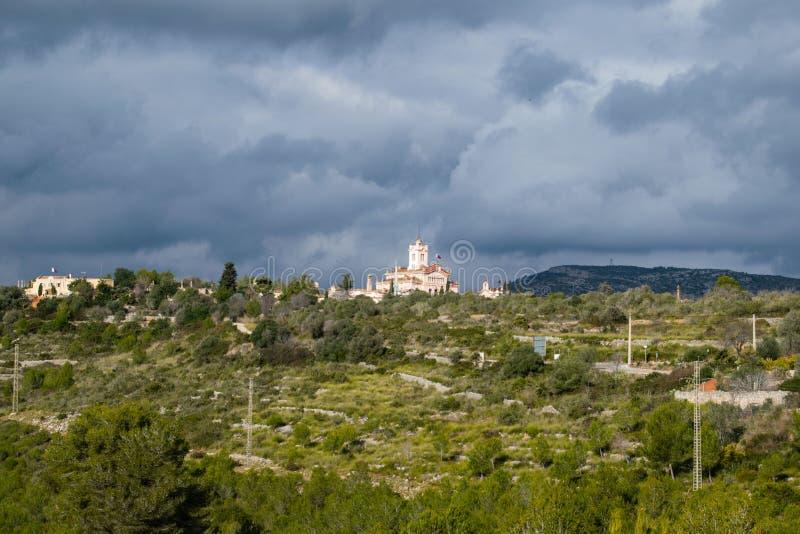 The beautiful town of Sitges with seagulls, Parròquia de Sant Bartomeu i Santa. The beautiful town of Sitges with seagulls, winter Spain, Landscape of the stock image