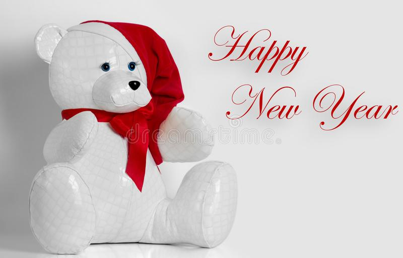 Beautiful toy bear wishes Happy New Year. A beautiful toy bear wishes Happy New Year royalty free stock photos