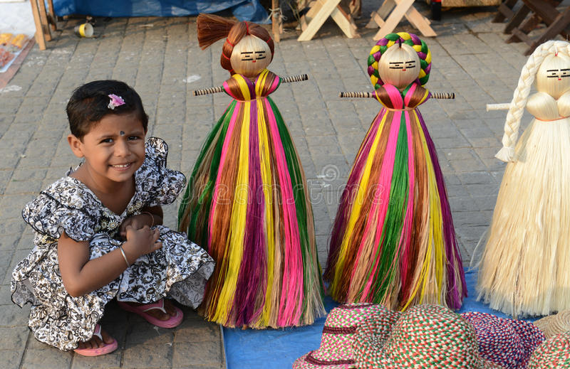 Beautiful Toys. A little girl posed beside jute made toys in the handicraft fair in Kolkata - this is the biggest handicrafts fair in Asia stock photography