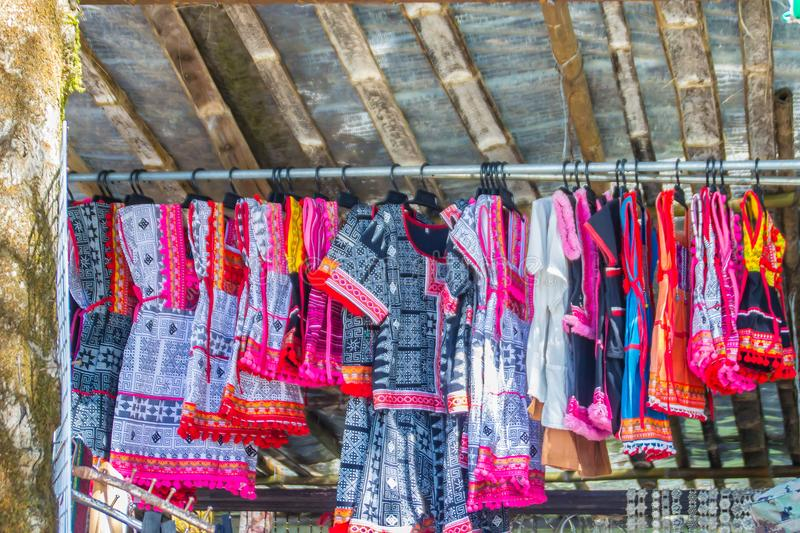 Beautiful traditional handmade clothes for sale to the tourist as the souvenir at the local market in hill tribe minority village royalty free stock images