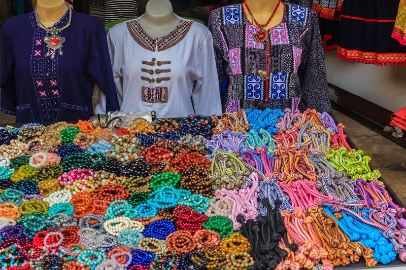 Beautiful traditional Hmong hill tribe clothing and ornaments for sale as souvenir at Doi Pui's Hmong ethnic hill-tribe village. Chiang Mai, Thailand stock photo