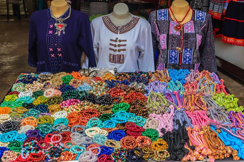 Beautiful traditional Hmong hill tribe clothing and ornaments for sale as souvenir at Doi Pui's Hmong ethnic hill-tribe village. Chiang Mai, Thailand stock photography