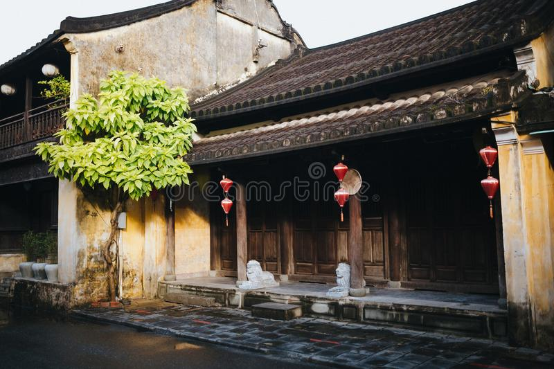 Beautiful traditional oriental architecture with red lanterns and statues in Hoi. An, Vietnam stock image