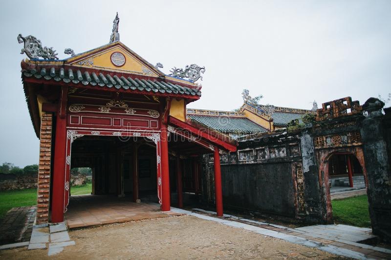 beautiful traditional oriental architecture and ruins of ancient wall royalty free stock photo