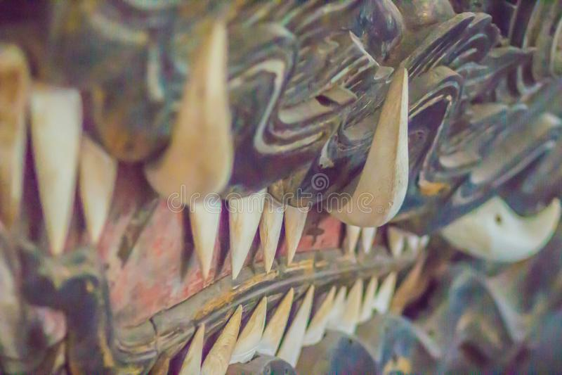 Beautiful traditional Thai style craving patterned of wooden royal barge. Golden monster head with fangs craved pattern of Suwan H royalty free stock photos