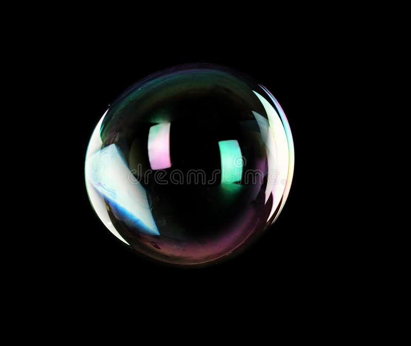 Beautiful translucent soap bubble on dark background. Space for text stock photo