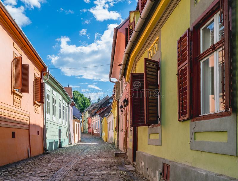 Beautiful Transylvanian street on a sunny summer day in Sighisoara, Romania. stock images