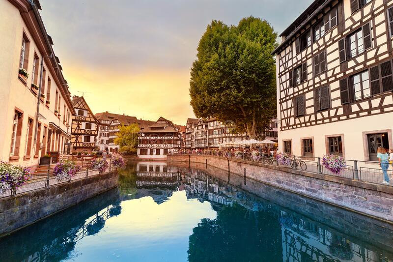 Travel landscape with half-timbered houses on the banks of the river ill and decorated flowers in Strasbourg. France and. Beautiful travel landscape with half royalty free stock photography