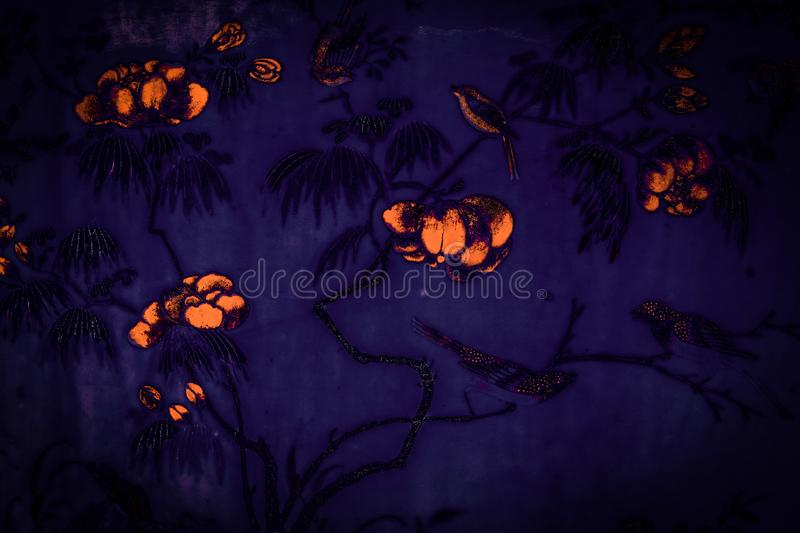 Beautiful tree bird and flowers art paintings colorful pink purple black white on black blue and yellow  pattern backgroun. D and wallpaper at Grand Palace royalty free stock images