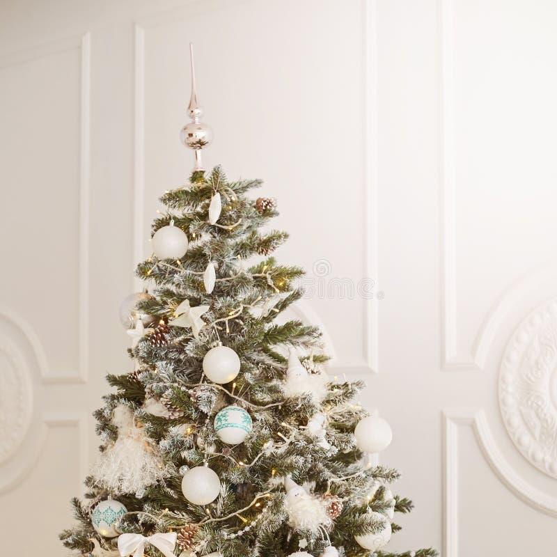 Beautiful tree. Bright interior. Christmas decorations royalty free stock photos