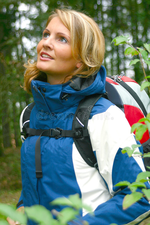 A beautiful Trekking Woman. A beautiful forest trekking woman royalty free stock image