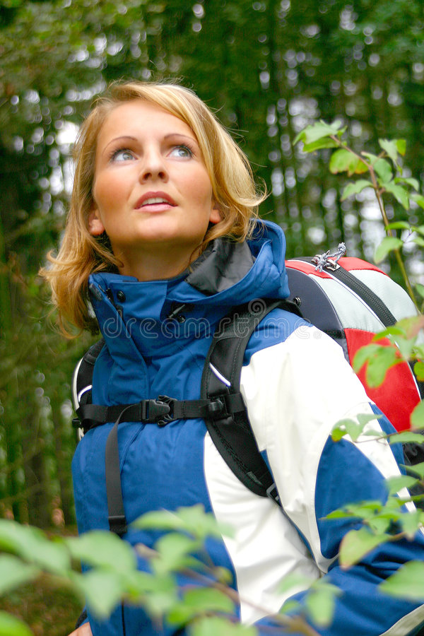 A beautiful Trekking Woman. A beautiful forest trekking woman royalty free stock photography