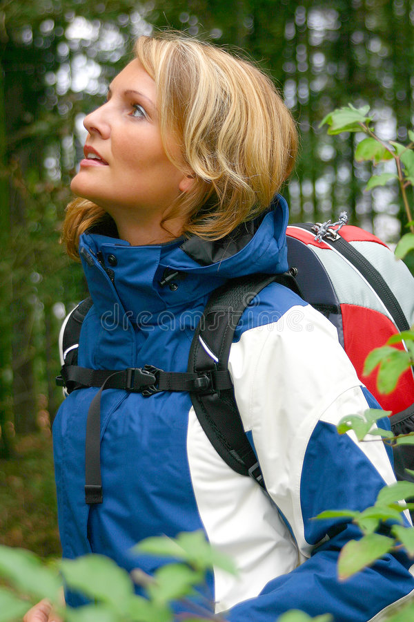 A beautiful Trekking Woman. A beautiful forest trekking woman royalty free stock images
