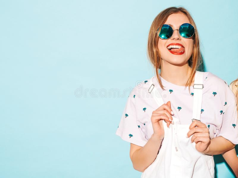 Beautiful trendy girl posing pin studio stock photography