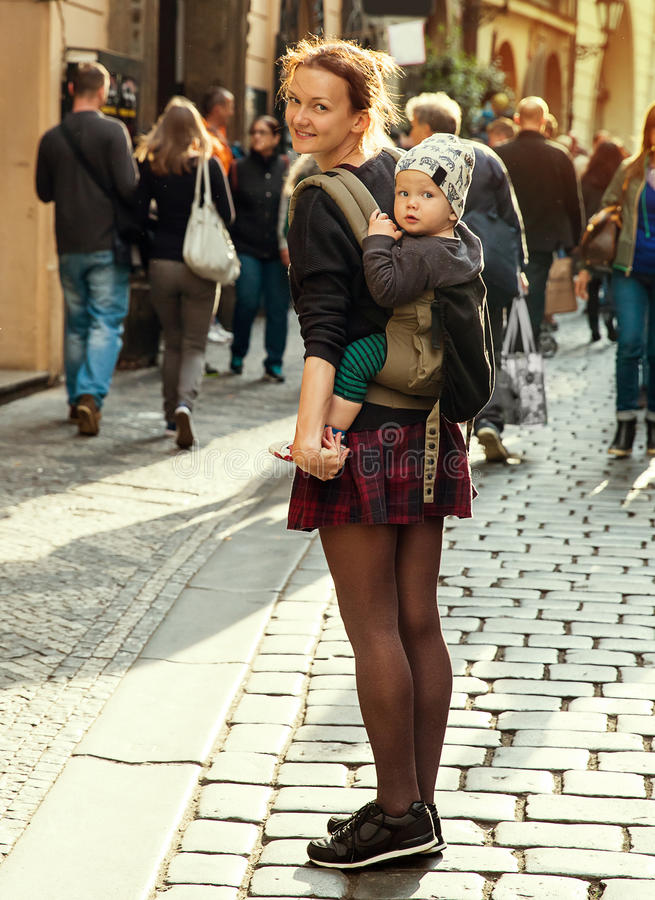 Beautiful, Trendy and Happy Family of Tourists on the Background of the Tourist Street of Prague stock image