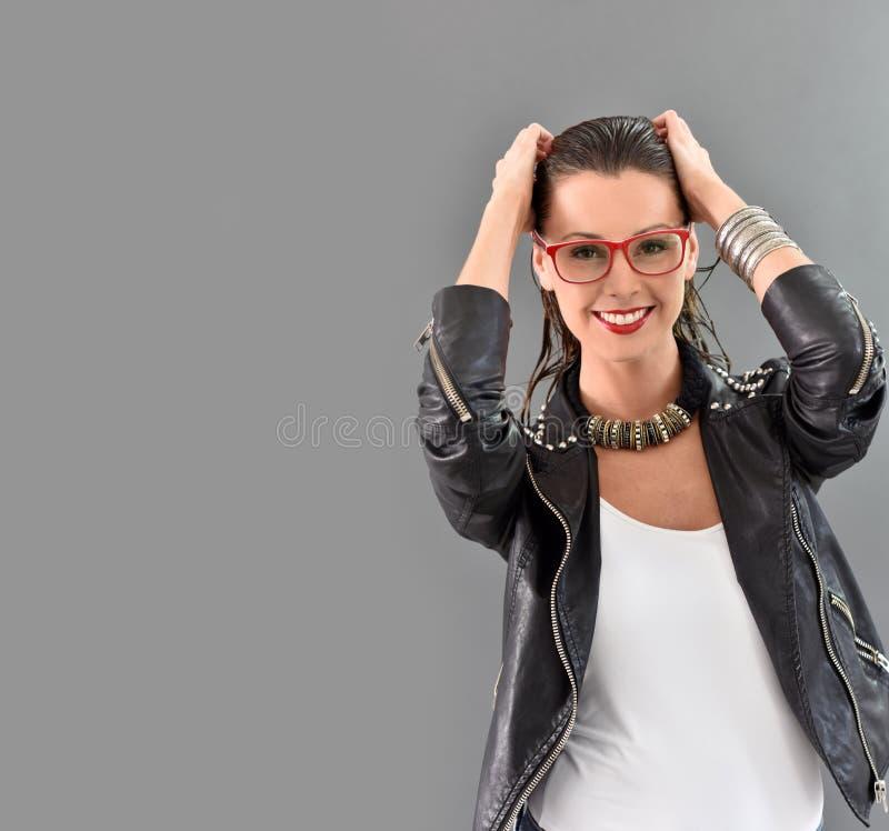 Beautiful trendy woman in rock look stock photos
