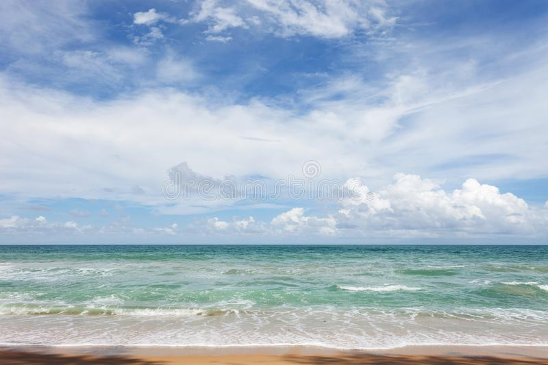 Beautiful tropical andaman seascape scenic off sandy beach phuket thailand with wave crashing on sandy shore. Beautiful tropical andaman seascape scenic off royalty free stock photography
