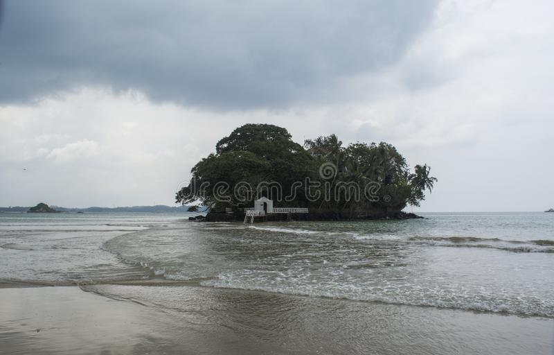 Beautiful tropical beach hotel located on small island in the ocean at Weligama town royalty free stock photography