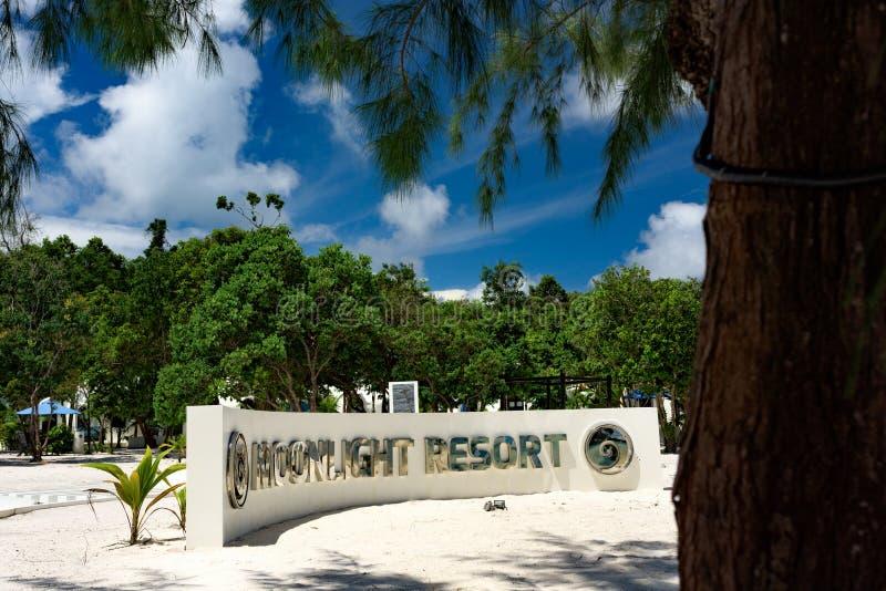 Beautiful tropical beach of the Koh Rong Samloem island with wall sign Moonlight resort royalty free stock photos
