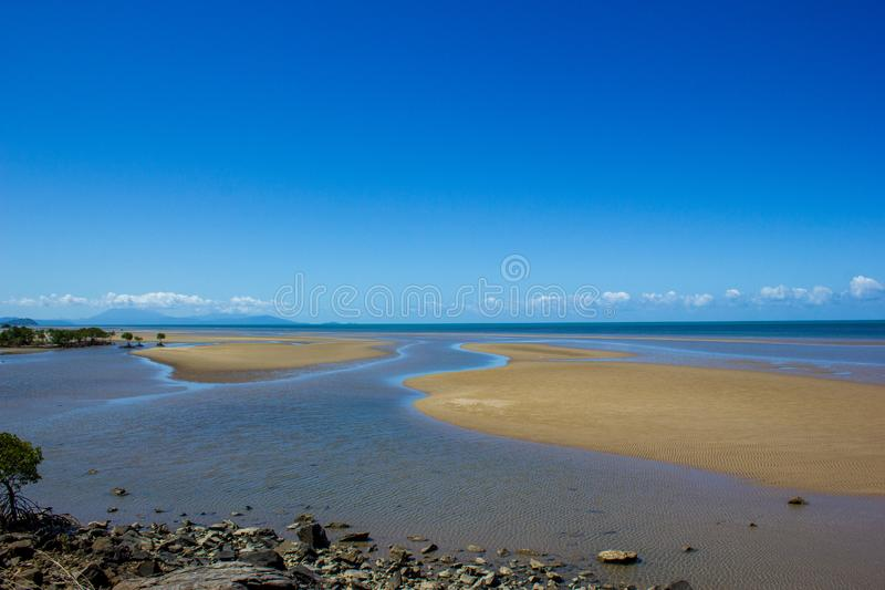 A beautiful tropical beach during low tide in northern Australia, cape tribulation, queensland, australia stock photos