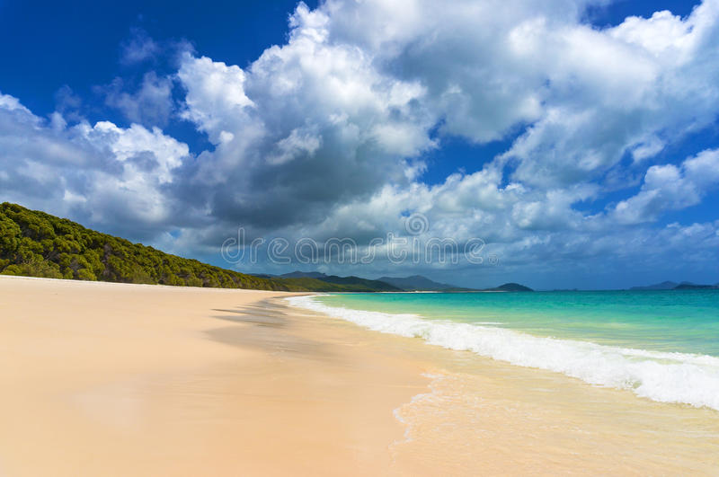 Beautiful tropical beach with picturesque cloudscape. Summer holiday, vacation background. Whitehaven beach on Whitsunday island, Queensland, Australia royalty free stock photos