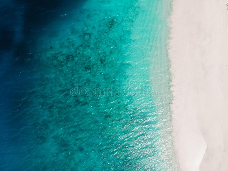 Beautiful tropical beach with turquoise crystal ocean, aerial view royalty free stock images