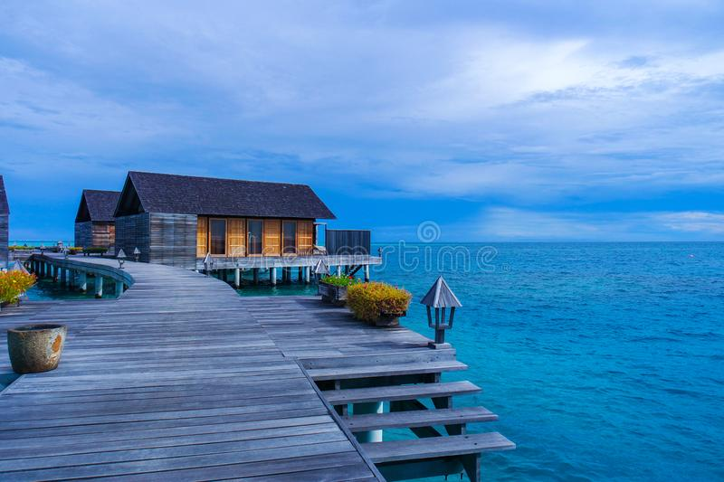 Beautiful tropical beach view with over water bungalows stock photos